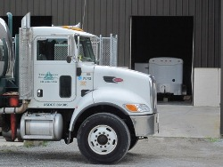 Triumvirate Environmental transfer facility and truck