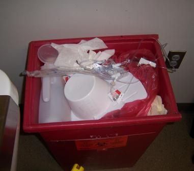 Medical waste container with medical supplies