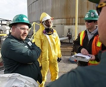 Occupational safety experts stand in a meeting