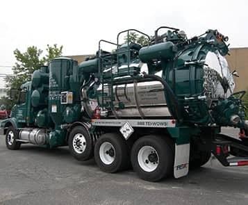 Triumvirate green vacuum truck
