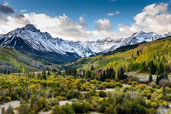 Snowy mountain range over green valley