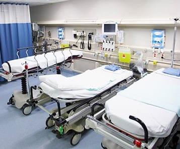 Empty hospital beds in emergency ward
