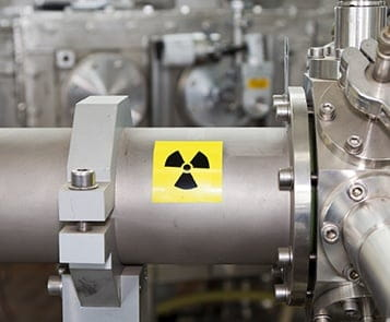 Radiation safety symbol on steel cylinder