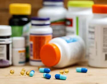 Spilled pills near DEA controlled substance bottles
