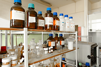 Chemical bottles on shelf_iStock-536350813_324x216
