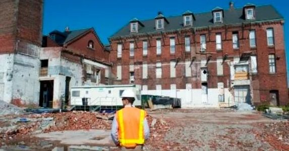 construction worker walking with hardhat and safety vest