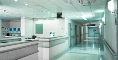 White hospital hallway with receptionist desk