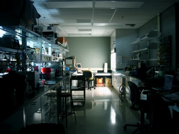 Dark laboratory with light on in the background