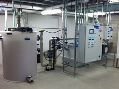 Wastewater pretreatment tank system inside facility