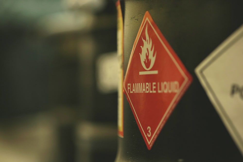 Red flammable liquid stick on the side of drum
