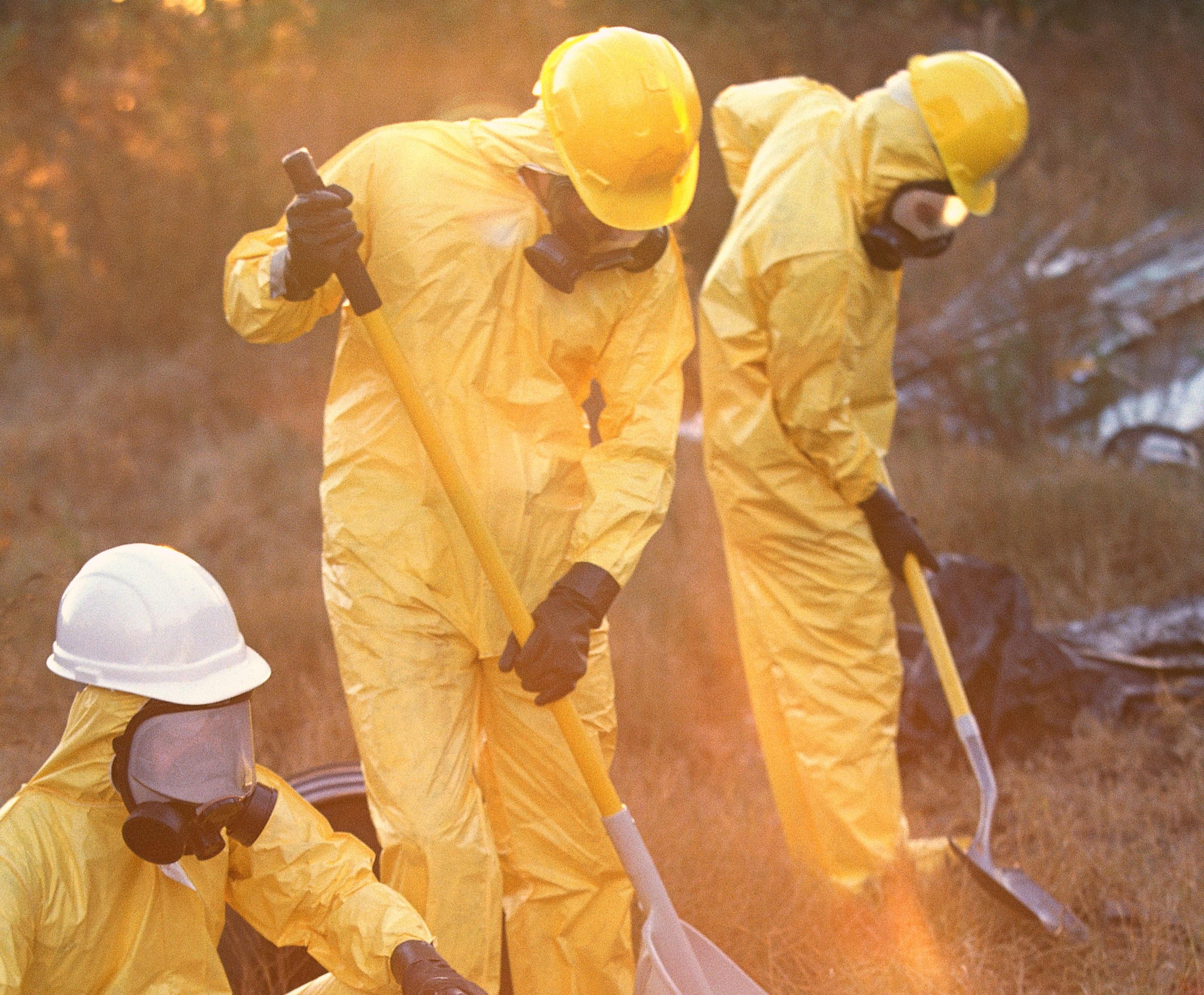 Workers wearing respirators