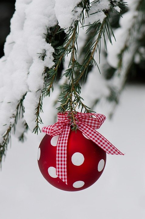 Red bauble holiday ornament with white polka dots and gingham ribbon